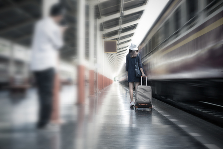 rapist: Dangerous Journey of Woman Concept, Voyeur unknow person following for take a photo the tourist woman at train station. Stock Photo