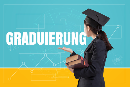 Graduated female girl holding the books with text: Graduation (in German)