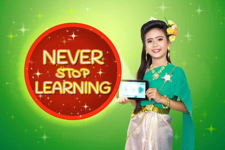 Traditional thai girl child with Never Stop Learning text. Stock Photo
