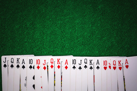 Close up poker casino cards on green gamble background.