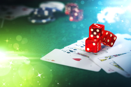 Dice on casino gamble table with colorful bokeh lighting effect. Stock Photo