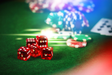 gambler: Poker Chips in casino gamble green table with colorful multi color lighting effect.