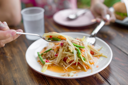 Close up papaya salad on the desk