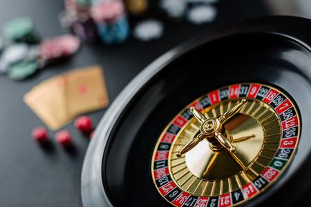 loser: Roulette wheel gambling in a casino table.