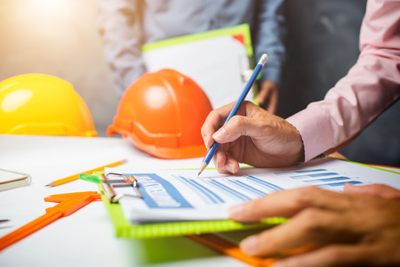 Structural engineer teamwork discussing hardworking in the office on building structure concept of worldwide building project. Stock Photo