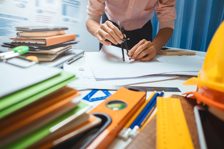 outerwear: Architect engineering worker working in office. Stock Photo