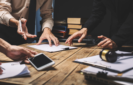 Teamwork of business lawyer meeting working hard about legal regislation in courtroom to help their customer. 版權商用圖片 - 81266713