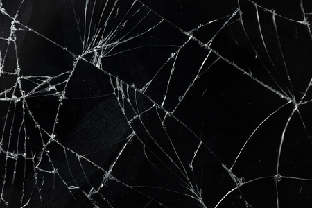 Top view cracked broken mobile screen glass texture background. Stockfoto