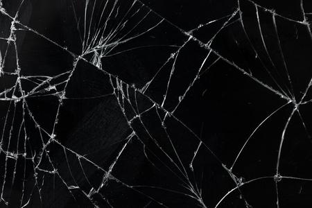 Top view cracked broken mobile screen glass texture background. Foto de archivo