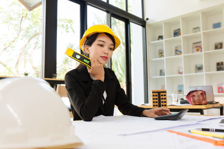 construction project: Business engineer working hard at construction site office workplace.