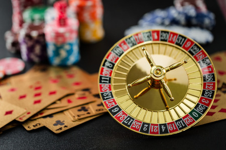 Roulette wheel gambling in a casino table close up.