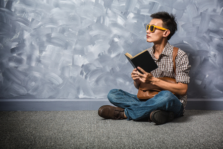 Hipster asian man reading a bible book, believe in God and faith, vintage hipster fashion style.