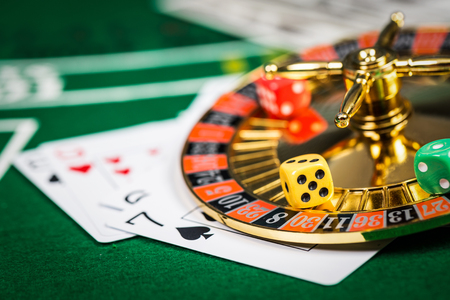 basic scheme: Vintage casino chips on green table with game cards. Stock Photo