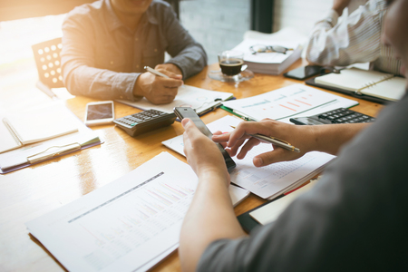 Co-workers are consultants on business documents, tax, transactions and business combinations after a bankrupt merger with a newly founded company. Stock Photo - 89720666