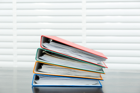 Paperwork pile messy of business financial put on desk.