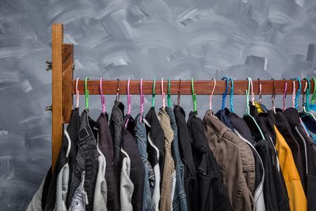Clothes rack clothes were hanging by a variety of colors for men older Asians. Stock Photo