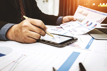 Bankers are analyzing financial data. To sum up the deposit and withdraw daily. Stock Photo