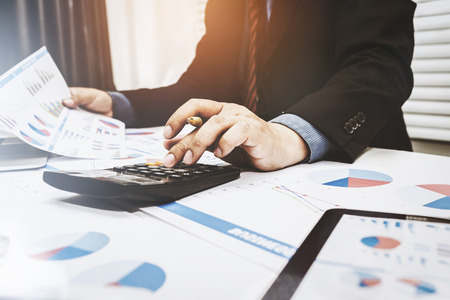 Financiers are calculating personal tax for customers who use the service. Stock Photo