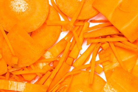 Close up slice of carrot organic food patter for background.