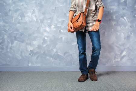 Vintage travelling men fashion with leather bag handsome thin man over loft concrete wall style.