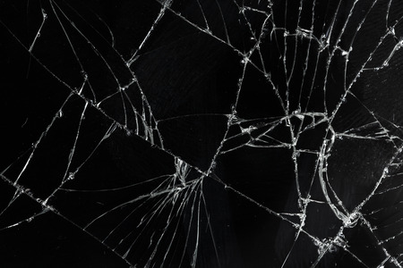 Top view cracked broken mobile screen glass texture background. Stockfoto