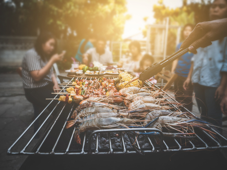 BBQ Party happy summer family dinner at home outdoor vintage style parent and child charcoal stove.
