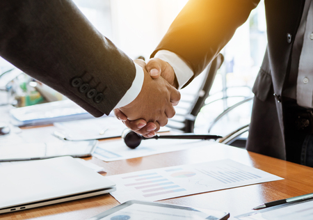 Shaking hands lawyer teamwork meeting businesspeople. Zdjęcie Seryjne