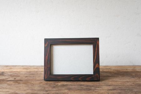 Wood frame photo old vintage put on grunge wooden table desk design equipment.