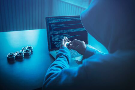 Asian people hacker wear a mask using a laptop cyber attack. Unlocked security via technology computer virus.