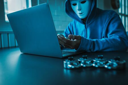 Asian people hacker wear a mask using a laptop cyber attack. Unlocked security via technology computer virus. Stock Photo - 133738768