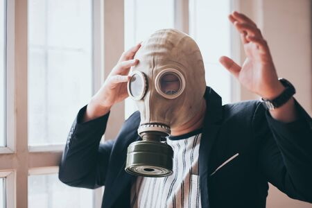 Business man with gas mask 2.5 pm problem pollution, business environment dangerous concept.