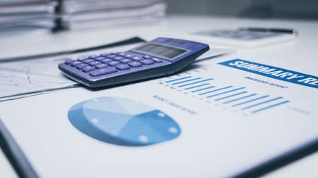 Close up calculator on table and financial paper planner document nobody.