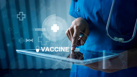 Medical doctor touching tablet with hologram for virus vaccine for use in the prevention and treatment of disease.