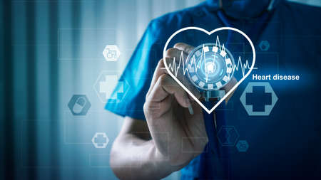 Medical doctor with heart disease healthcare and medical services with AR interface cardiogram illness concept. Фото со стока