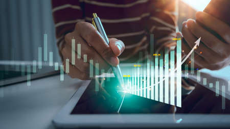 Business woman trader with stock market projects growth graphs running and increase statistics rates.