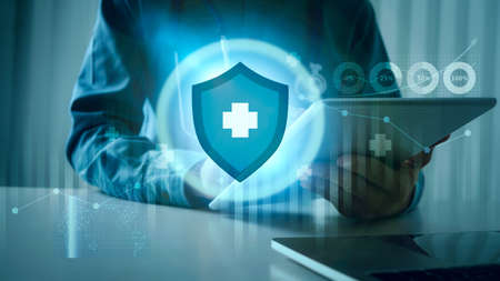 Medical doctor using tablet with immune system futuristic AI design for safety from danger virus and bacterial, immunity shield.
