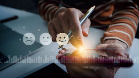 Customer pressing mobile screen face emoticon on vr screen, rating of customer satisfaction with the use of virtual screens.