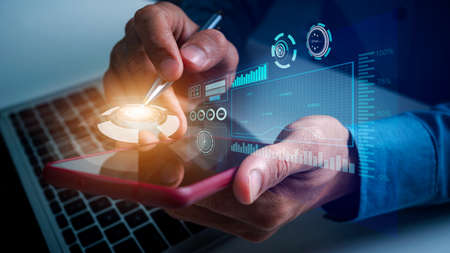 Business man using mobile update tasks with VR financial chart scheduling virtual diagram and milestones progress planning, pen pointing on top of mobile.