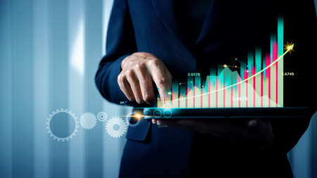 Business Intelligence (BI) and Big data for business management in the retail industry, Professional business woman holding tablet with business analytics (BA) digital virtual reality (VR) financial dashboard.