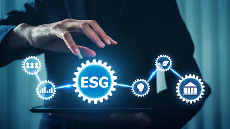 Business woman with ESG environment green business concept, hand holding tablet gear virtual reality of environment social governance concept. Фото со стока