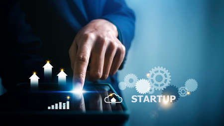 Startup concept, business person woman touching tablet with  financial graph data technology modern virtual interface.