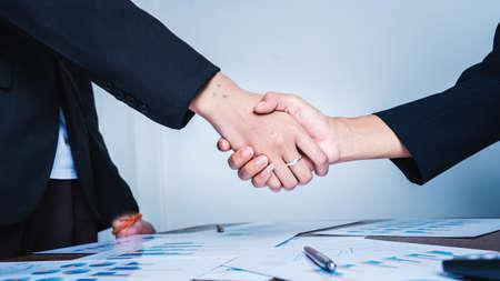 Shaking hands at meeting of business women teamwork success concept.