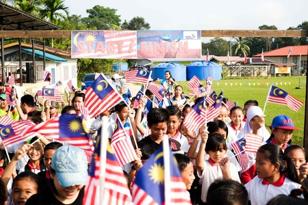 17 August 2018 , Sipitang - Children along with their parents and teachers walk together during the launching of Indepence Day Celebration in the morning Editorial