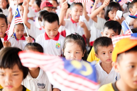 17 August 2018, Sipitang - Children singing National Anthem during Launching of Independence Day Celebration in the morning