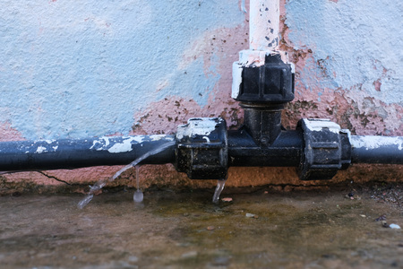 Water leakage  from old pipe.