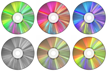 Six CDs in a variety of colors.