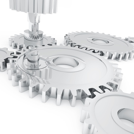 Gears in chrome stacked next to each other on a white background