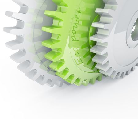 Green gear behind chrome mechanical gears Stock Photo
