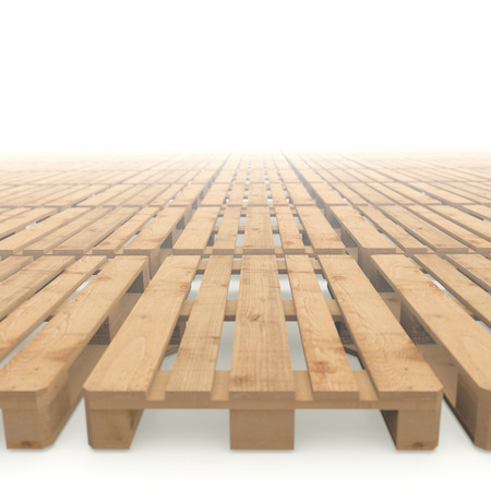 Lots of wooden pallets stacked on a white background disappearing in the fog Stock Photo