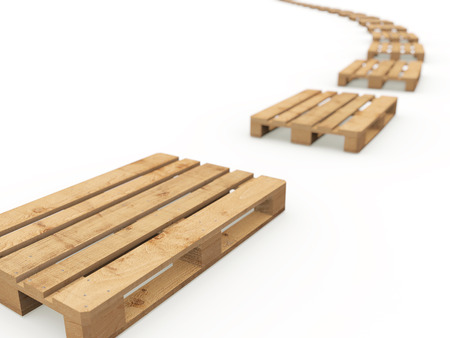 The curved row of wooden pallets on a white background